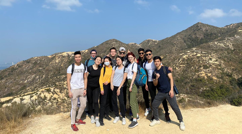Khachatur <em>(1<sup>st</sup> left, back row)</em> and Andy <em>(1<sup>st</sup> right, front row)</em> go hiking with their friends <em>(courtesy of interviewee)</em>