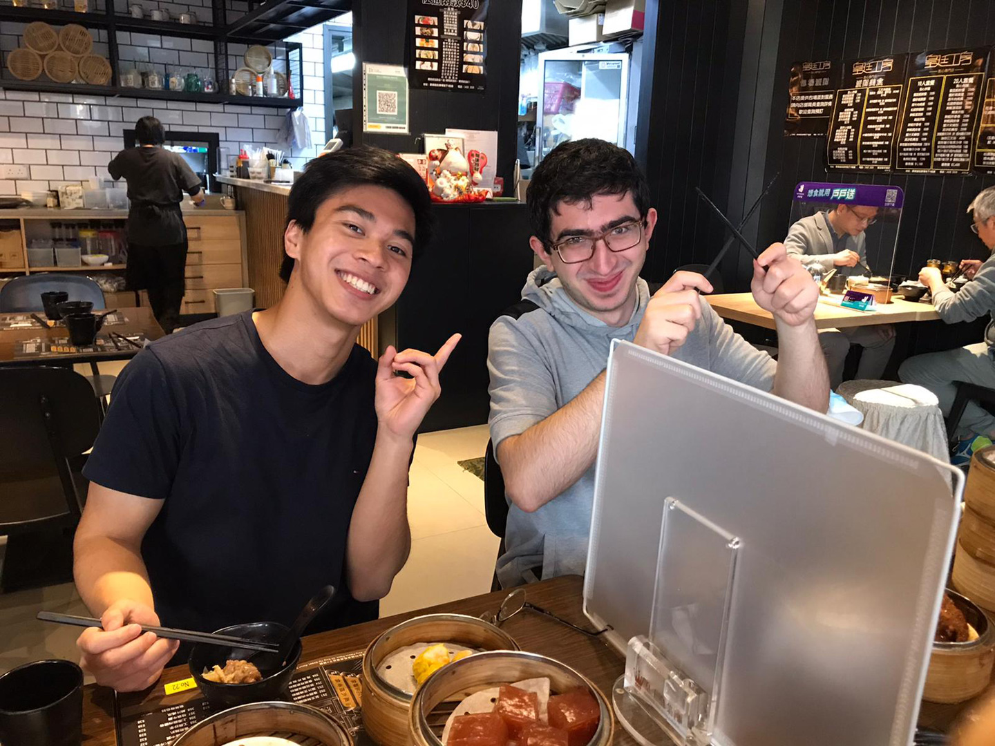 Andy, gourmet of Cantonese dishes, and Khachatur, apprentice of chopstick mastery <em>(courtesy of interviewee)</em>