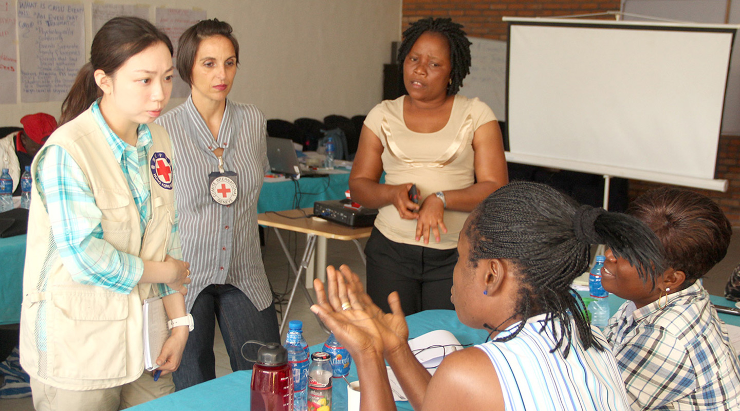 Conducting a training session for local counsellors in Liberia
