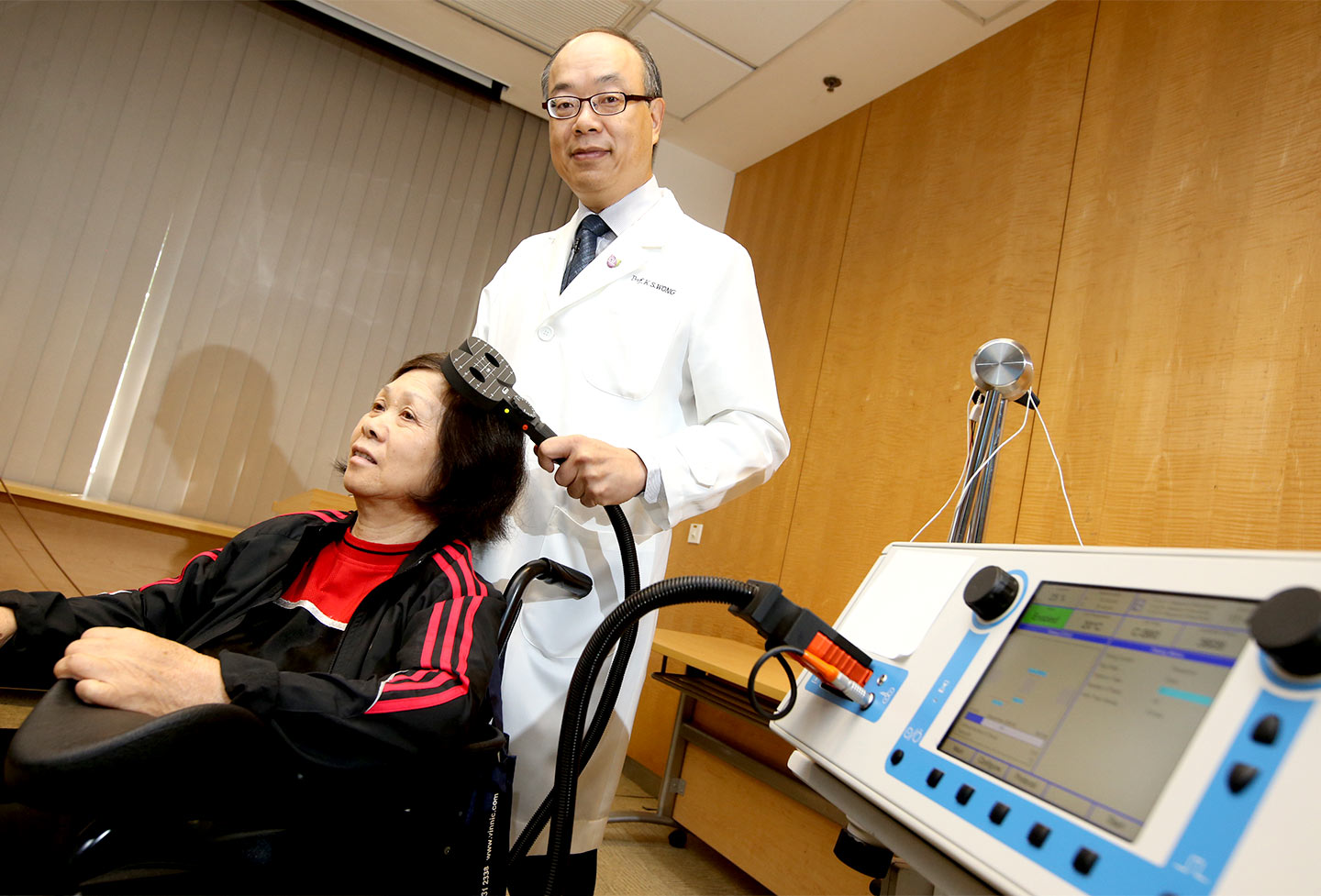 Prof. Lawrence Wong demonstrating iTBS treatments on a stroke patient