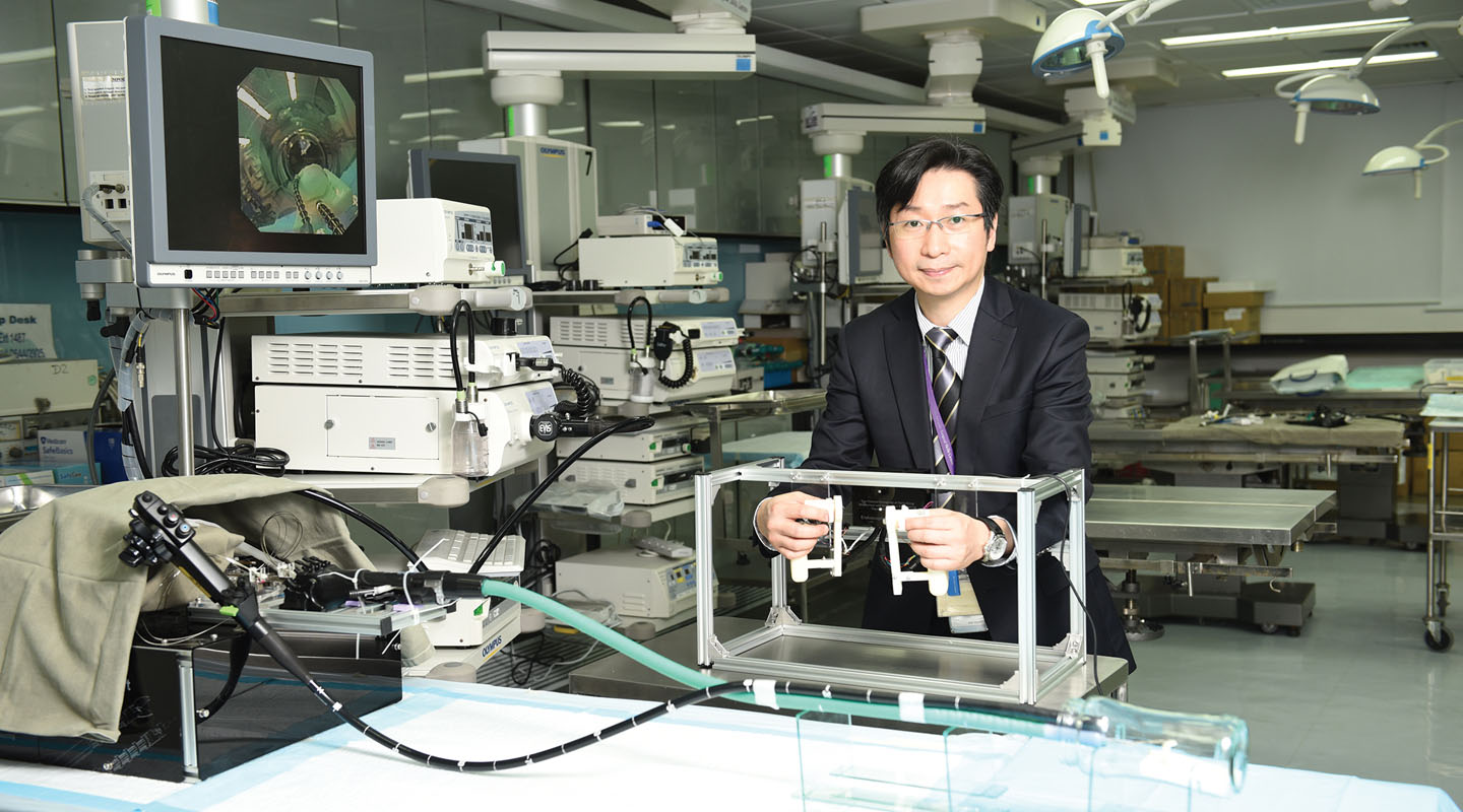 Philip Chiu demonstrates the use of the endoscopic surgical robot to perform ESD