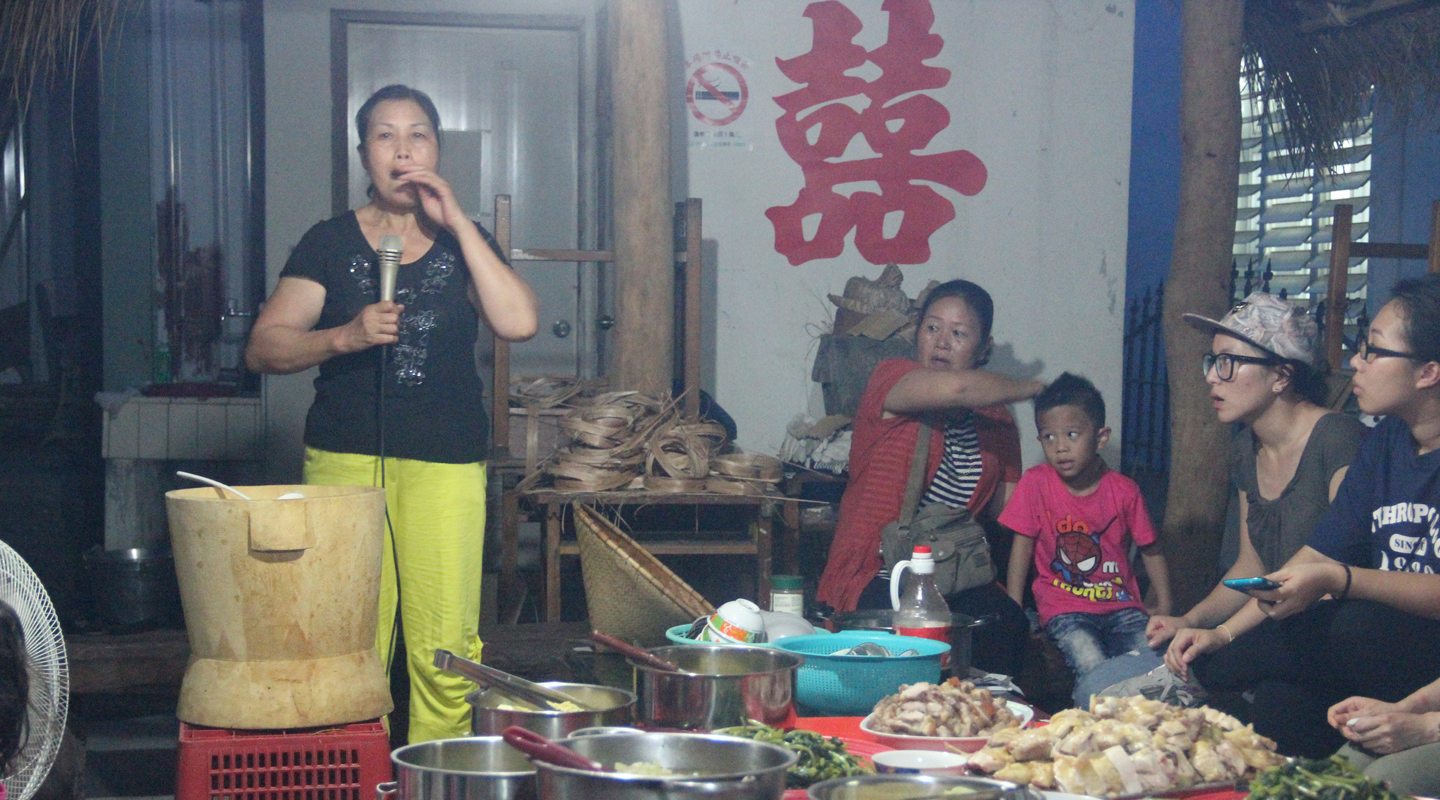 In the 2014 annual field trip, the staff and students of the department visited Doulan in Taitung, Taiwan. This photo was taken in a farewell party for the students with the host explaining about the traditional food and culinary practices of the Amis, an indigenous people of Taiwan <br /><em>(Source: The blog of the anthropology department, 5 December 2014)