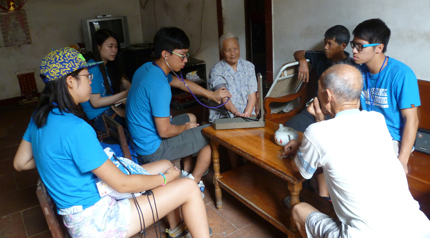 Students visit villagers in China to test their blood pressure and other vital statistics