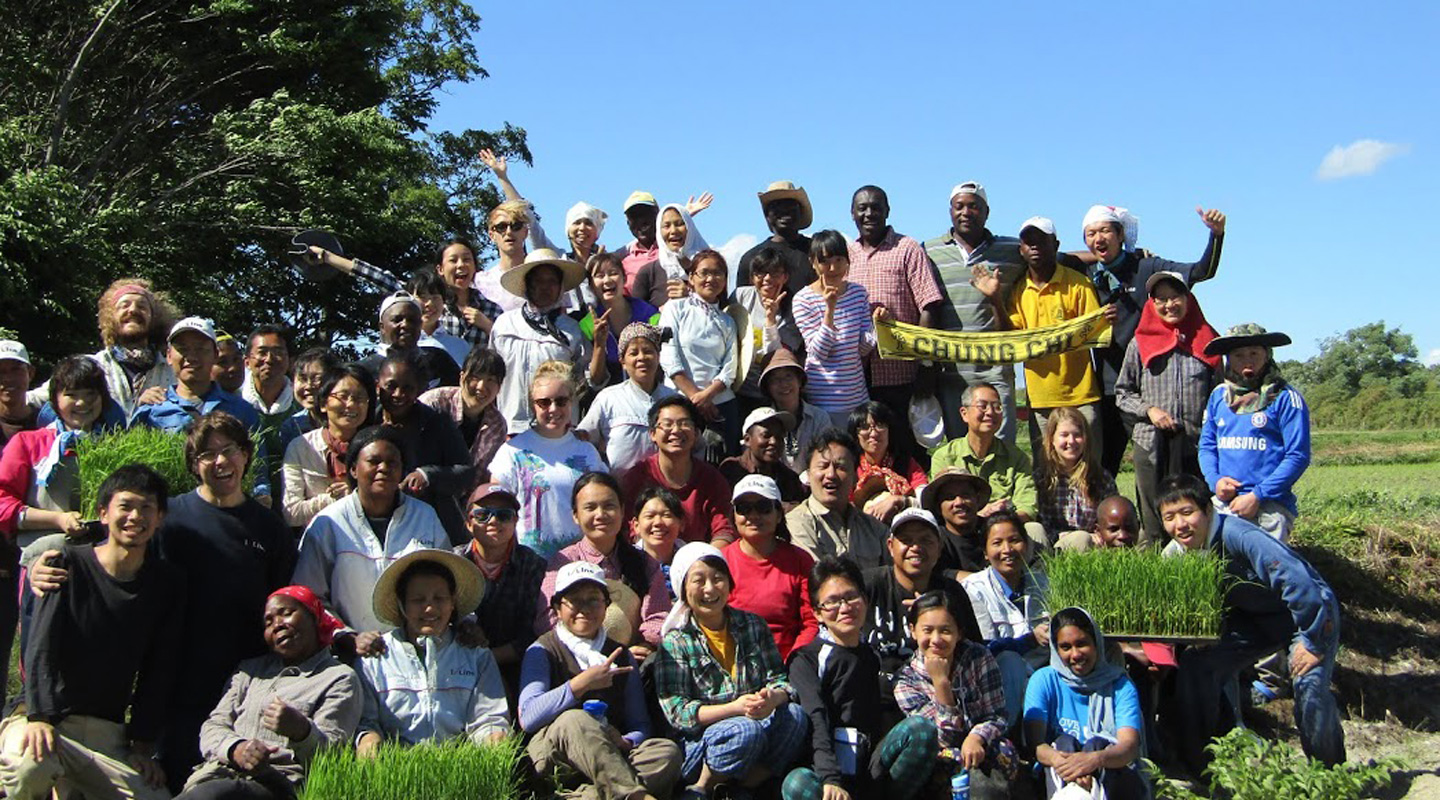 Students from around the world work on an experimental farm in Japan