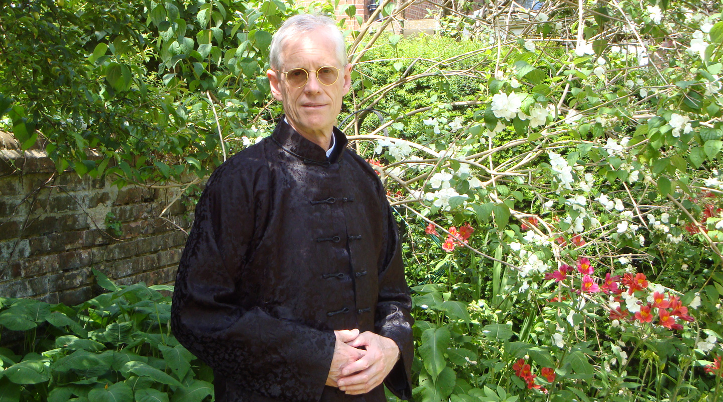 Dressing in <em>cheongsam</em> in his home garden in Oxford