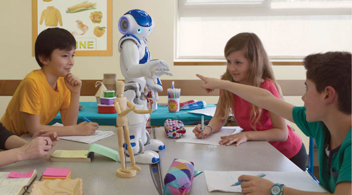 With the help of NAO, children are trained to recognize commonly used gestures, including certain markers and iconic gestures. <em>(Photo: Aldebaran)</em>
